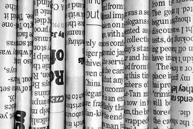 Row of Newspapers in black and white