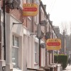 Estate agent signs on domestic property 'Let By'