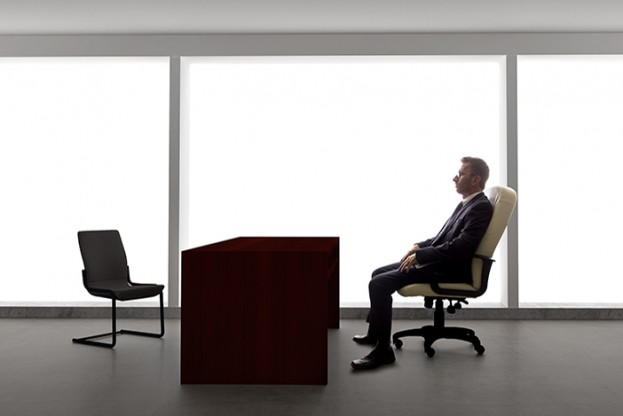 Businessman with an empty chair waiting for a late client