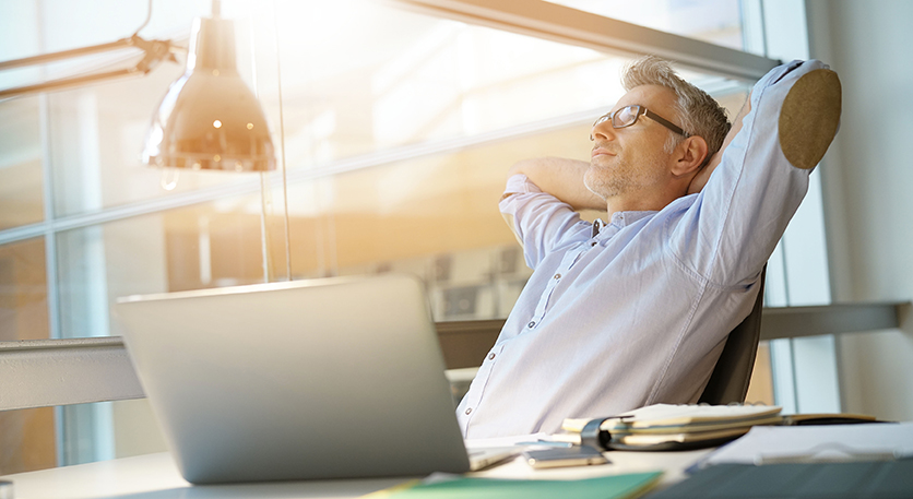 Businessman in office relaxing in chair