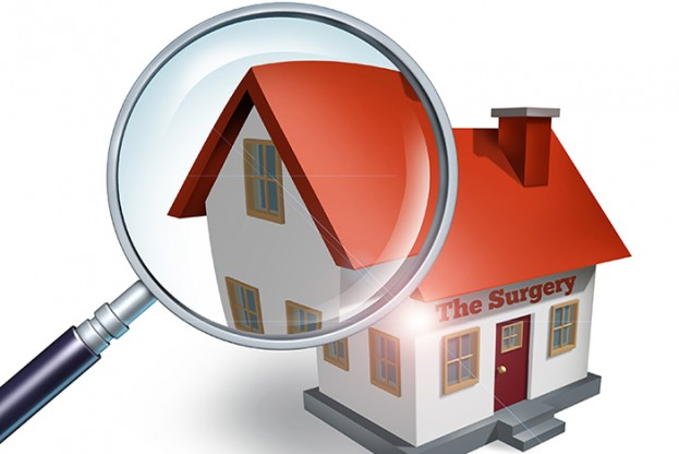 House hunting and searching for real estate homes for sale  that need to be inspected by a home inspector concept as a magnifying glass inspecting a model single home building structure.