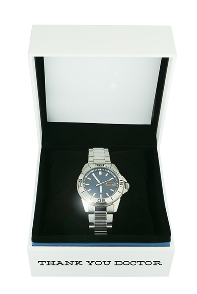 white box with luxury watch on white background