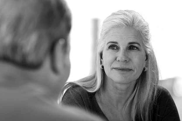 Charming mature caucasian woman talking with a male friend