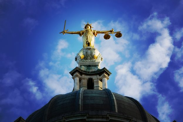 Lady justice on the top of the Old Bailey in London, England, processed Photoshop Lomo effect.